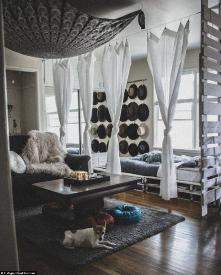 Audristorme has also opted for a neutral colour palette with shades of grey and white, and turned her hat storage problem into an opportunity for a feature wall