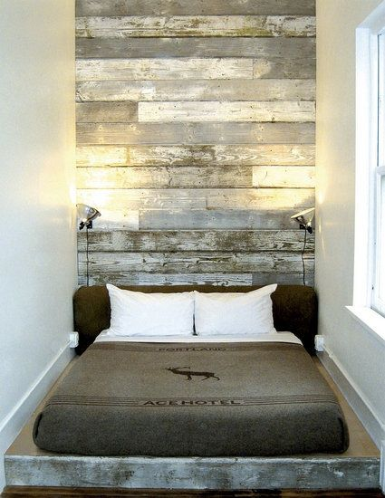 The Ace Hotel in Portland created a dramatic salvaged wood headboard by simply cladding the entire wall behind the bed in boards.