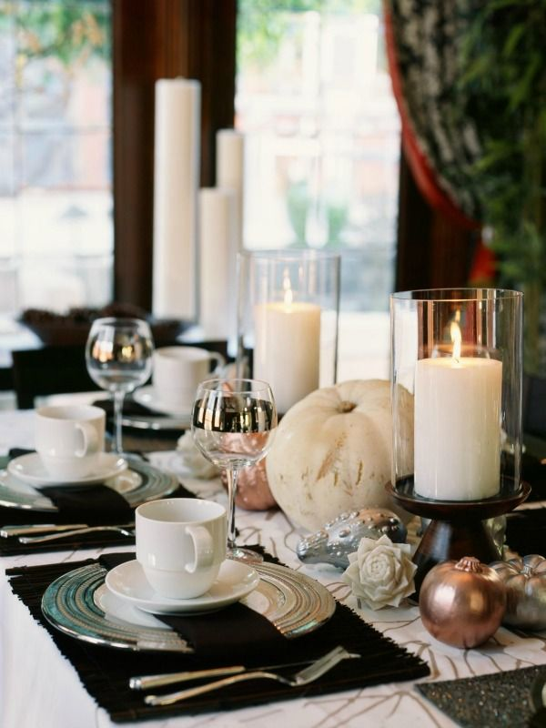 Bountiful Centerpiece with a white ghost pumpkin and pillar candles.