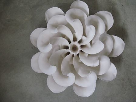 Astrid Dahl produces organic pieces inspired by leaf, flower and seed capsule shapes that are sculpted in matt, bone-white clay. www.midlandsmeander.co.za