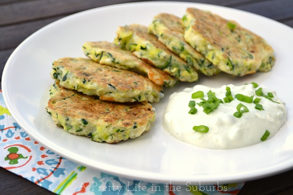 Zucchini Fritters with Tzatziki Serves: Makes about 24 fritters.   Ingredients 4 cups shredded zucchini (about 3 medium zucchini) ½ – 1 tsp coarse salt 4 oz feta cheese, crumbled (about ¼ cup) 4-6 green onions, minced ½ cup chopped fresh dill 2 cloves garlic, minced 2 eggs ½ cup sorghum flour (I have also used oat flour) 1 tbsp corn starch ½ tsp baking powder