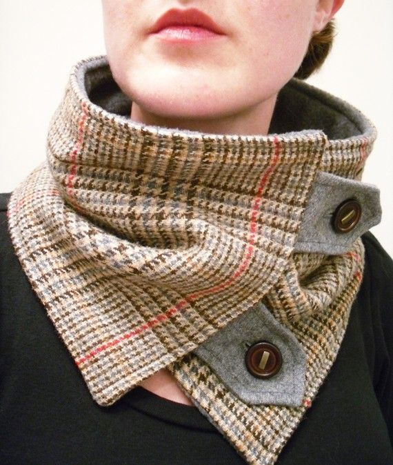 This neck warmer is classy and upcycled! Made out of upcycled materials.  Material includes colors of brown, tan, red-orange, and gray.  Button flaps
