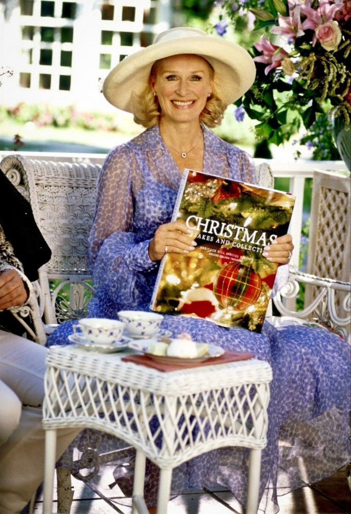 """Glenn Close in The Stepford Wives, 2004, with """"the most important book any of us will ever read"""". Just look at that grin, sort of savage (""""interfere with my way of life at your peril!"""") Glenn Close plays crazy better than most any actor, ever!"""