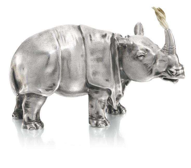 A FABERGÉ SILVER TABLE LIGHTER, WORKMASTER JULIUS RAPPOPORT, ST PETERSBURG, CIRCA 1890 naturalistically modelled as a rhinoceros, struck with workmaster's initials and Fabergé in Cyrillic beneath the Imperial Warrant, 88 standard, scratched inventory number 9330 length 16cm, 6 1/4 in.