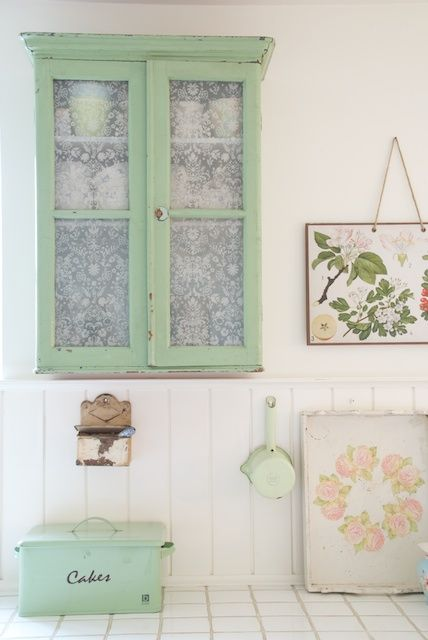 love this cabinet - looks like a sheer, lace curtain on the inside doors - very sweet - the pale green is soothing too