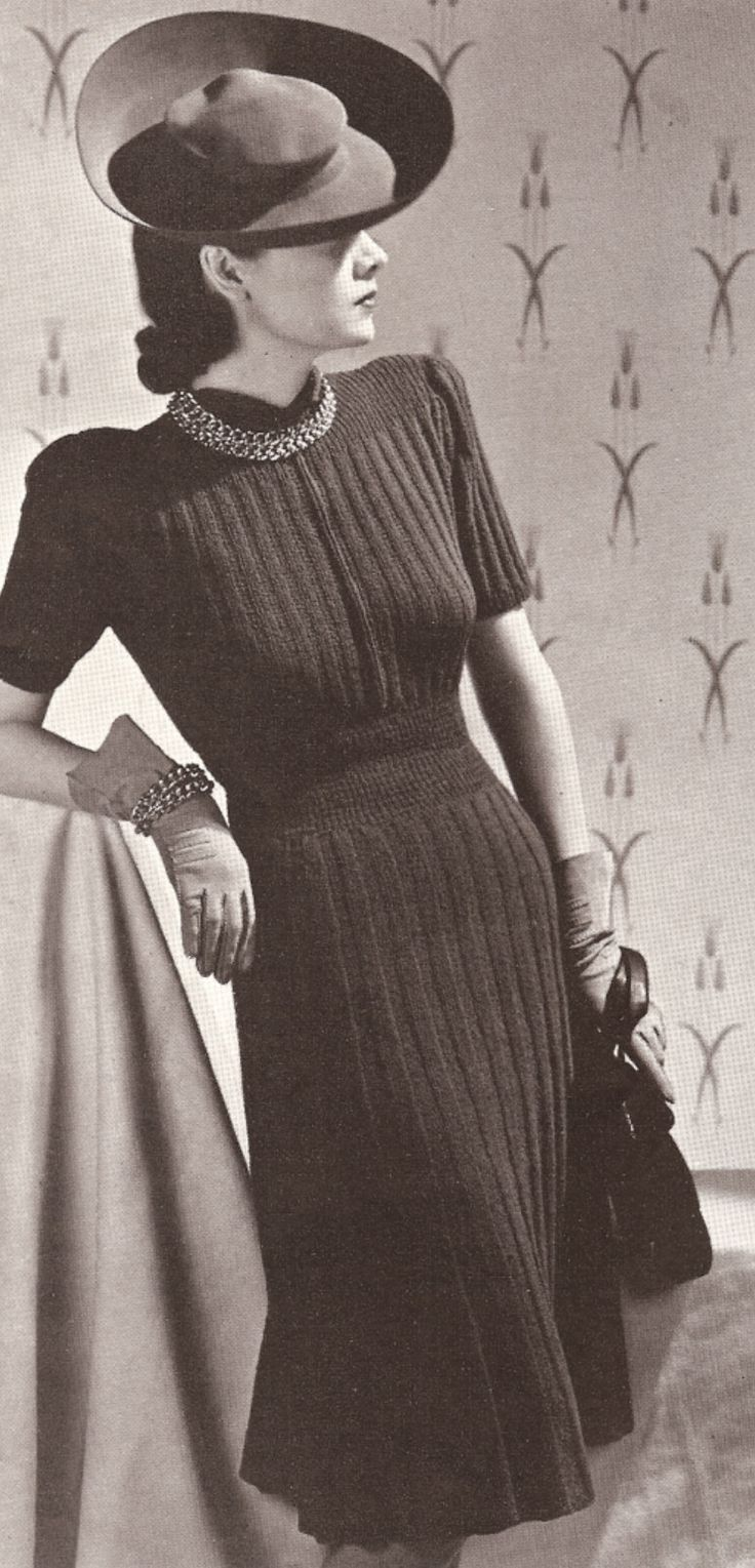 This images shows the increasing popularity with knits during the 1930s. We also see her pictured in a wide brimmed hat, a popular look of the 1930s.