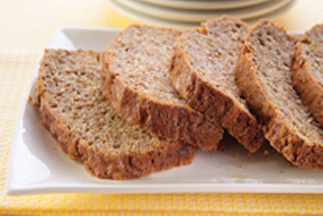 Mashed ripe bananas and bran cereal are baked into this easy quick loaf. Serve slices for breakfast or a snack.