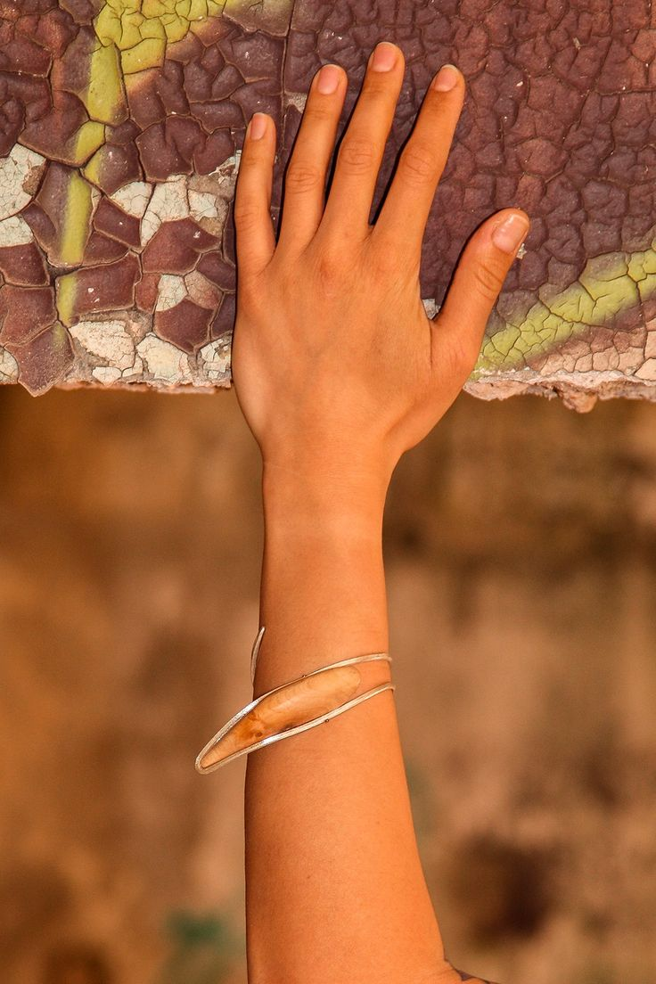 Olive Wood and Silver Bracelet - Imprisoned Woman Photo Credit: Nicholas Stavropoulos
