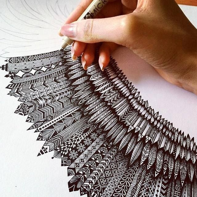 Something VERY much like this for the patterns and how they are attached. But The shape must be a big feather, not like a wing like this is now. Like an eagle feather. #Zentangle