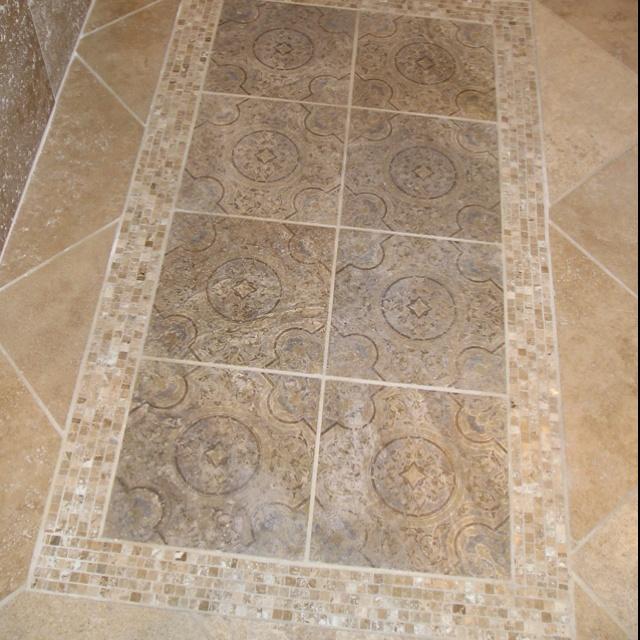 Bathroom tile mimicking rug