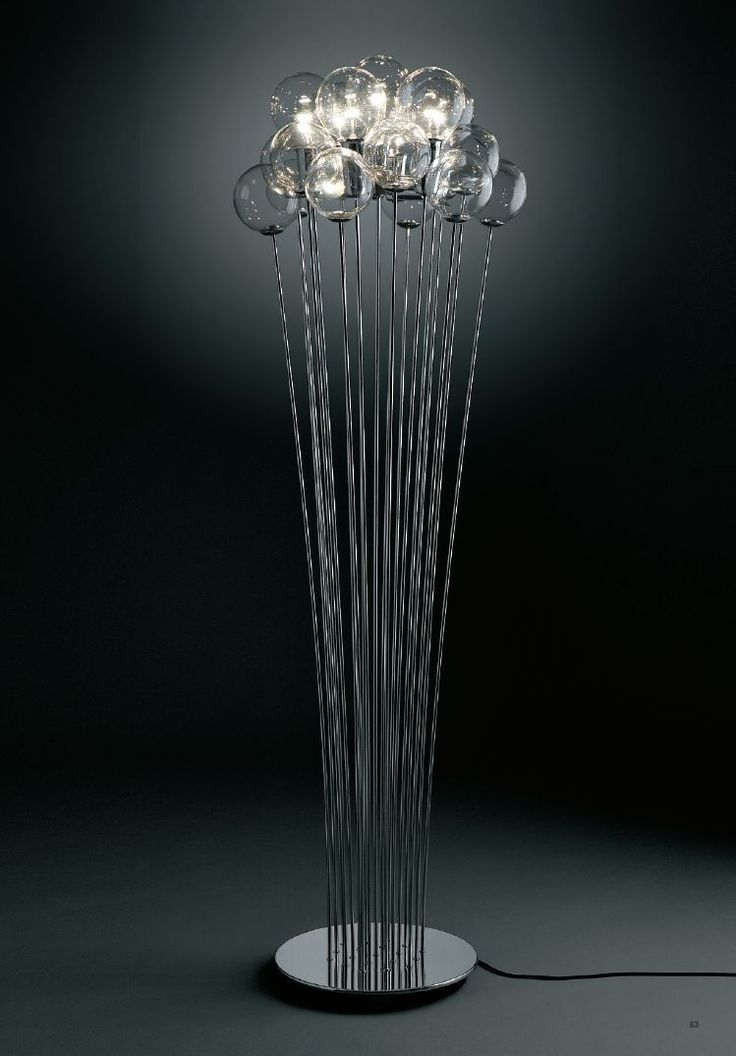 Lamp with crystal blown spheres, and bulb socket covers in chromed metal frame. 7 long life globe bulbs, 3 standard bulbs and 12 spheres. design by Marco Agnoli for SP LIGHT and DESIGN srl