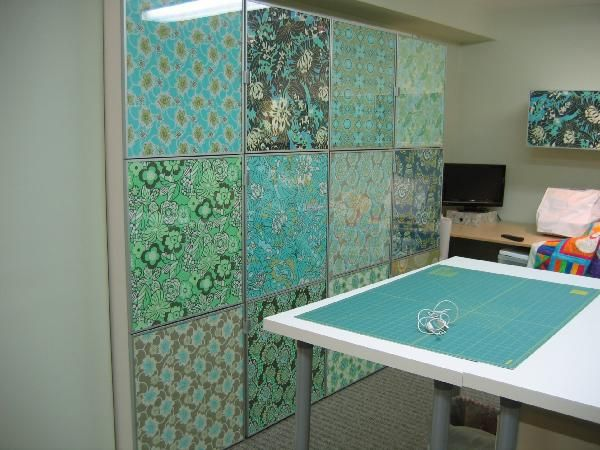 Ikea cabinets with fabric covered doors.