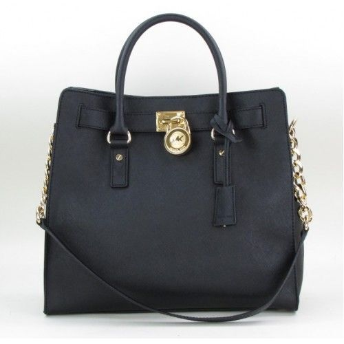 Michael Kors...simple black bag with gold accents.