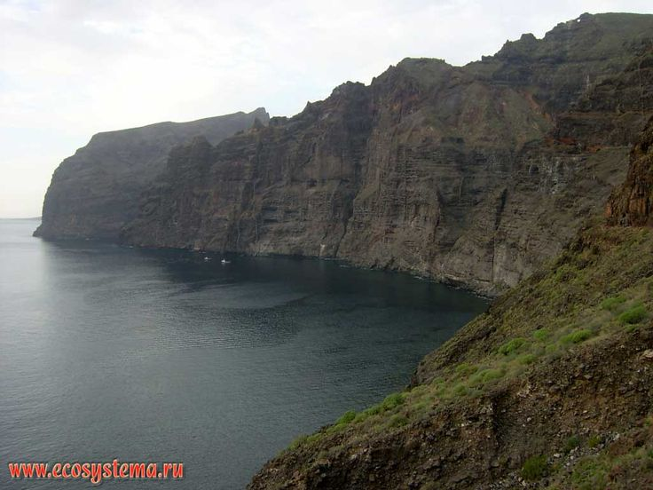 Coastal cliffs - open-cast of the volcanic barranco. Cliff height is about 500 meters. Los Gigantes area, north-west coast of the Tenerife Island, Canary Archipelago
