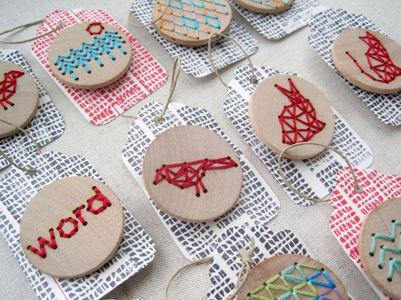 Love this idea of embroidery on wood.  Never seen anyone do this before.