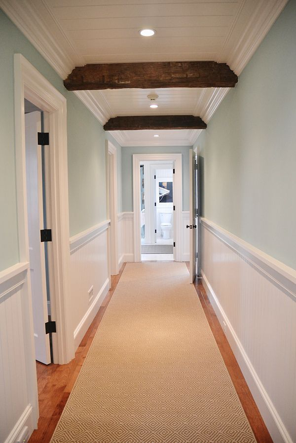 HGTV Dream Home 2015. Sherwin Williams Watery in this stunning hallway with white wainscoting and wood beams. #Watery #Hallway