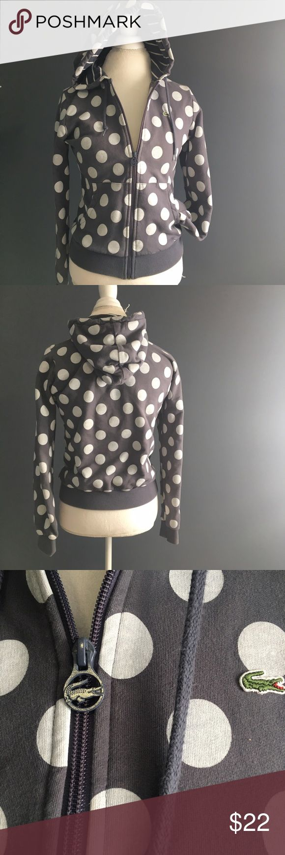 Lacoste Polka Dot Zip Up Hoody Size 40 Women's Lacoste gray hoody with white polka dots size 40/large. But fits like a small/medium. Great used condition. Only flaw is the inner armpits have been bleached by deodorant. It is not visible from the outside. (See photos). Otherwise it is in excellent condition. Lacoste Tops Sweatshirts & Hoodies
