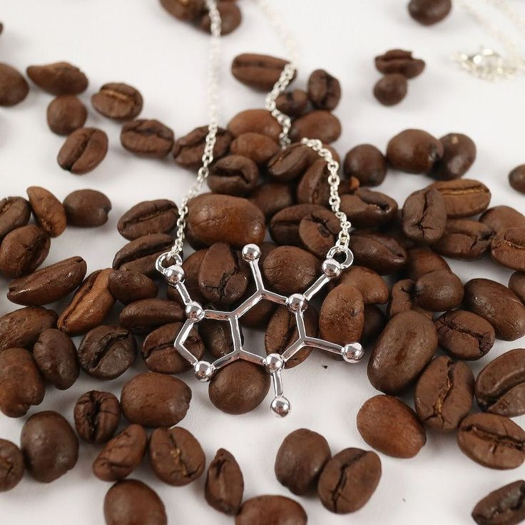 Just our caffeine (coffee) molecule necklace on some coffee beans.  Free shipping find it at moleculestore.com  Caffeine is a bitter white crystalline xanthine alkaloid that is a psychoactive stimulant. In humans caffeine acts as a central nervous system (CNS) stimulant temporarily warding off drowsiness and restoring alertness. Caffeine is the worlds most widely consumed psychoactive substance but unlike many other psychoactive substances is legal and unregulated in nearly all…