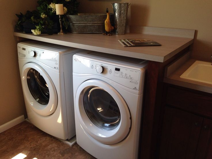 Counter top over front load washer and dryer looks nicer and offers more storage space dream - Best washer and dryer for small spaces property ...