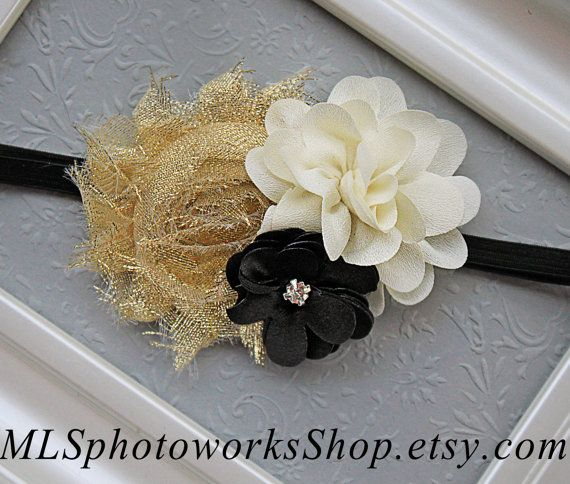 This headband features a beautiful cluster of flowers in shimmery gold, ivory and black. The flowers together measure about 3.5 across and are