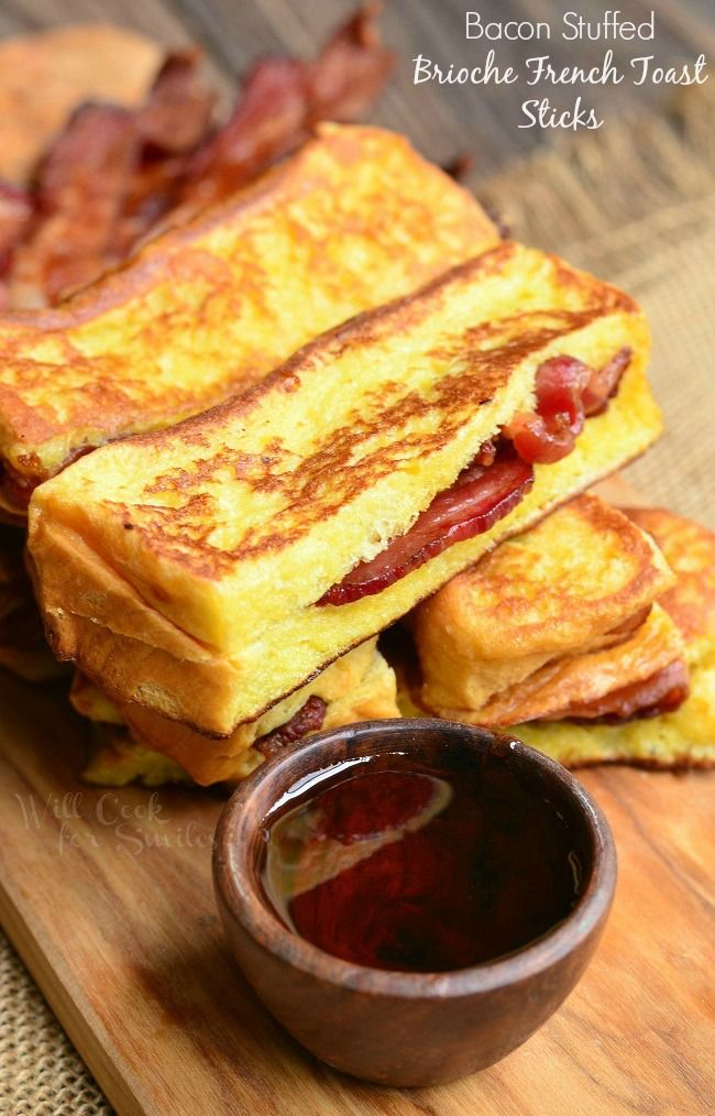 Bacon Stuffed Brioche French Toast Sticks. Out of this world delicious French Toast made from Brioche bread and stuffed with crispy bacon.  | from willcookforsmiles.com