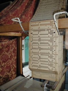 JACQUARD'S LOOM and the stored programme concept - The Jacquard loom was invented by Joseph Marie Jacquard in Lyon in 1801 to weave textiles, mainly silk. It stored weaving programmes in a series of punched cards. In a process that was very reminiscent of that once used to create computer programs a design would be drawn on paper and a punch card machine would be used to create a set of cards. These were then stitched together.