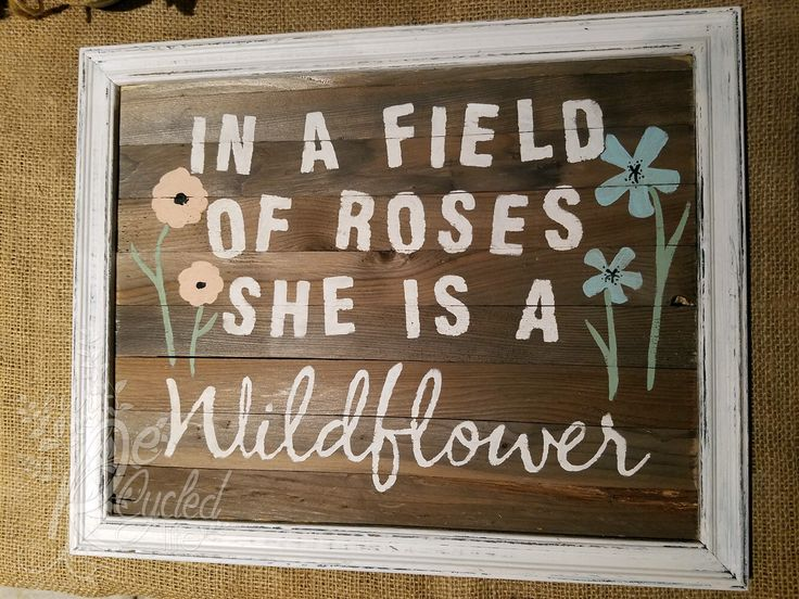 """Reclaimed wood sign """"In a field of roses she is a WILDFLOWER"""" by OurRecycledLife on Etsy https://www.etsy.com/listing/291824121/reclaimed-wood-sign-in-a-field-of-roses"""