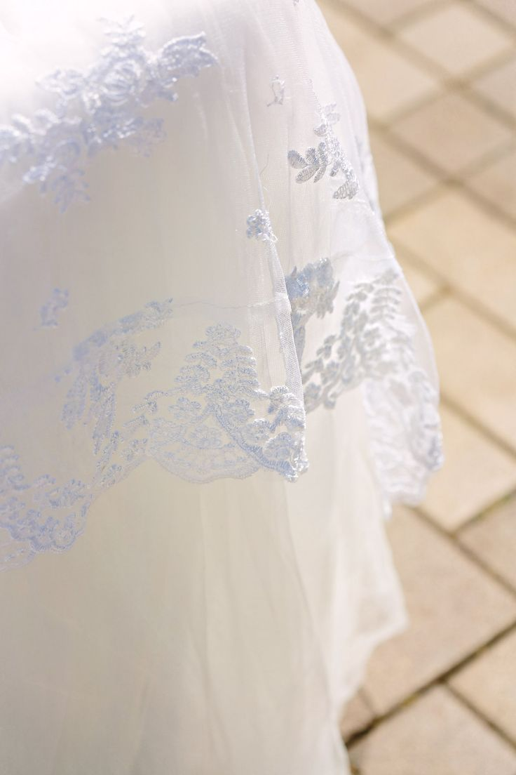 Mrs. Freund & Co. Christina Lace Table Overlay   This is a gorgeous scalloped lace table overlay that can be made and then  dyed to match any of our tulle/organza colors. Shown here in White over our  Ivory Tulle Tutu Tablecloth - get the contrast look by picking a shade  lighter or darker than your linen to make the lace pop.  Photo by Kath