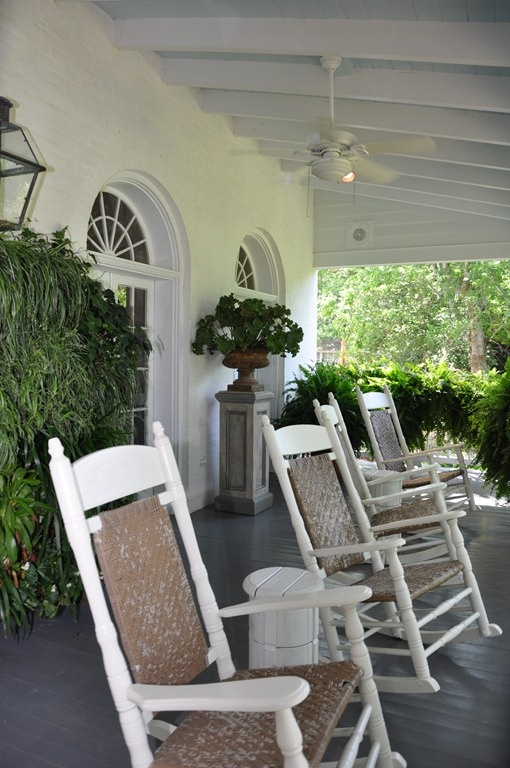 Old fashioned rockers on a lovely traditional porch. Baton Rouge, Louisiana, designed by Ryan Cole.
