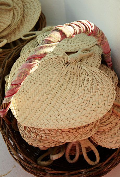 Brides.com: A Springtime Destination Wedding in Tulum, Mexico. Rattan fans kept guests cool as they sat in the sun.