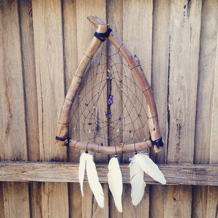Custom made wooden dreamcatcher with black hemp rope, amethyst & quartz crystal beads, white cockatoo feathers and an amethyst crystal centrepiece #crystal #craft #triangle #dreamcatcher #handmade #handicraft #cockatoo #feathers #beads #amethyst #weave #artwork #macrame #creation #quartz #hemp #hempcord