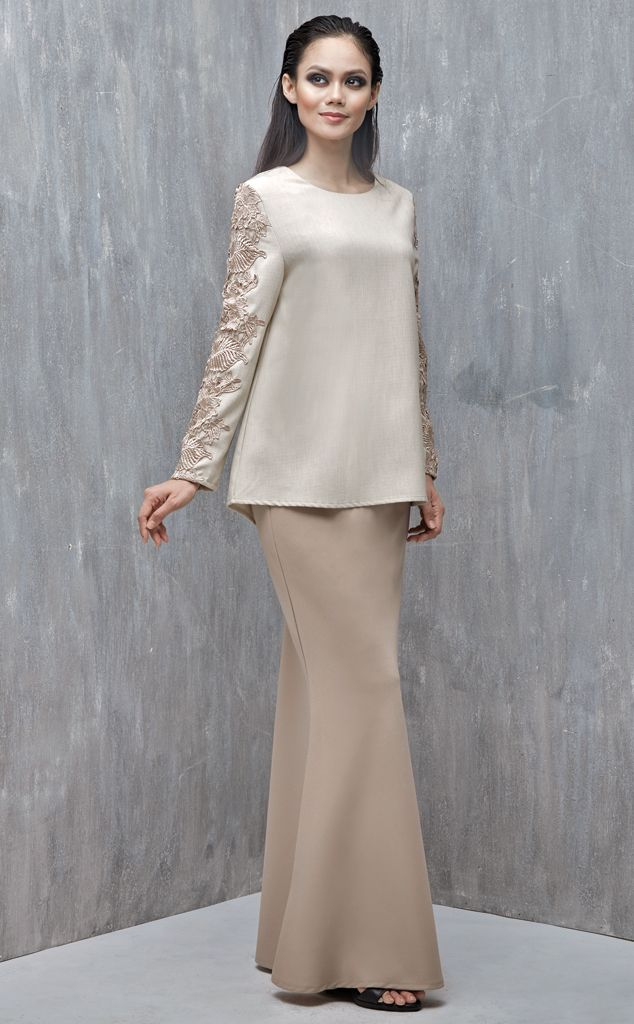 EMEL X DAPHNE IKING - LONGHORN - Modern A-line Baju Kurung with Lace (Nude) This A-line modern baju kurung is all about the class and simplicity with border lace on the sleeves. Also, the top is a tweed inspired fabric that's makes a lovely ensemble with the border lace. #emelxCLPTS #emelxDaphneIking #emelbymelindalooi #bajuraya #bajukurung #emel2016 #raya2016 #DaphneIking #lookbook #aline #lace #nude #moden