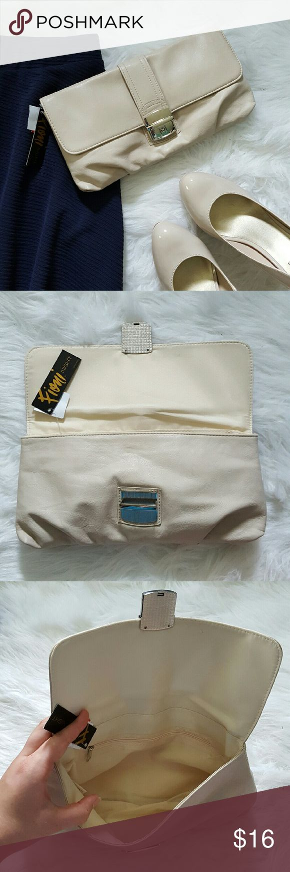 """Stone Sabrina Push Lock Clutch Fioni brand. Stone (cream, beige, tan) color. 'Sabrina' style bag.  Faux leather exterior. Silver tone hardware - push lock front closure. Satin Polyester lined interior. Inside zip pocket. 12"""" x 6"""" x 1"""" closed dimensions. New with tags. FIONI Clothing Bags Clutches & Wristlets"""