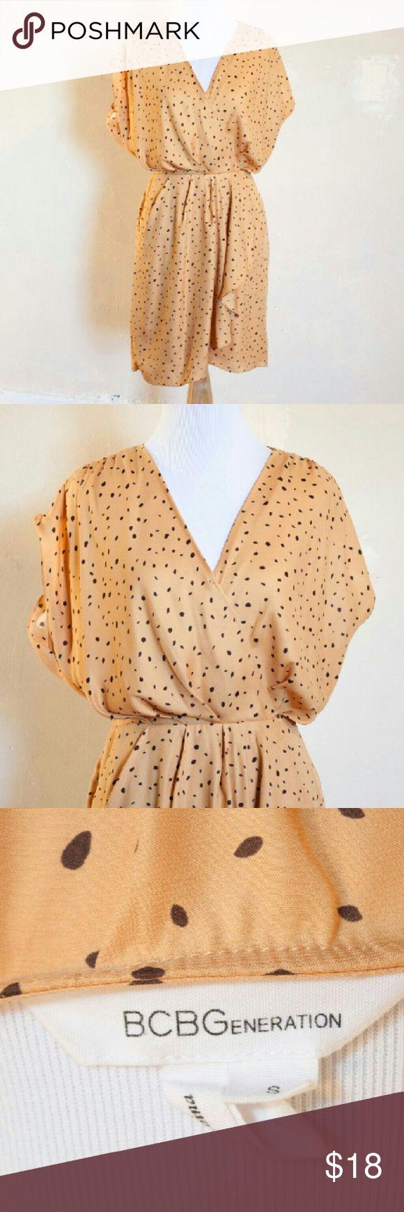 BCBGeneration Dress Very pretty pale yellow polka dot dress. BCBGeneration Dresses Midi