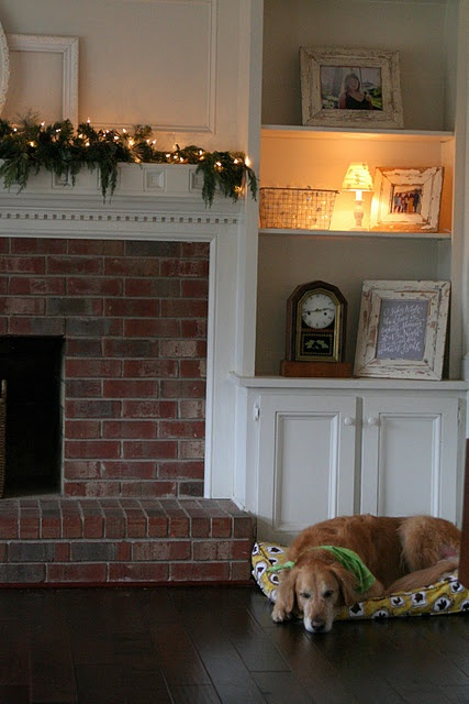 built in bookshelves around fireplace, could cover some of the brick with paneling and shelving