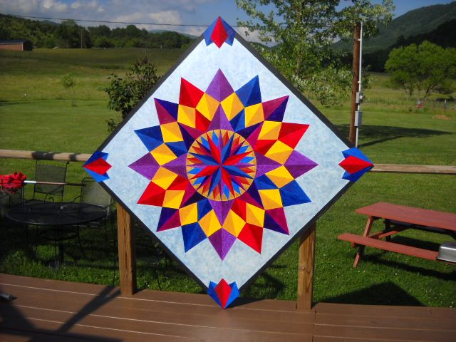 Painting this barn quilt art in bright colors gives it a contemporary spin.