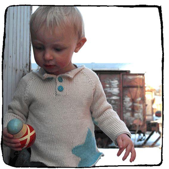 Raglan sweater with star pattern.
