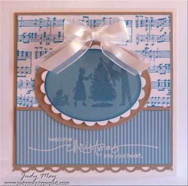 """""""Welcome Christmas..."""" is stamped in Versamark and embossed with white embossing powder."""