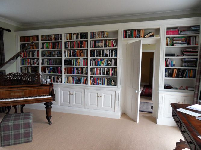 A Verny Bespoke wall to wall bookcase fitted around a door.