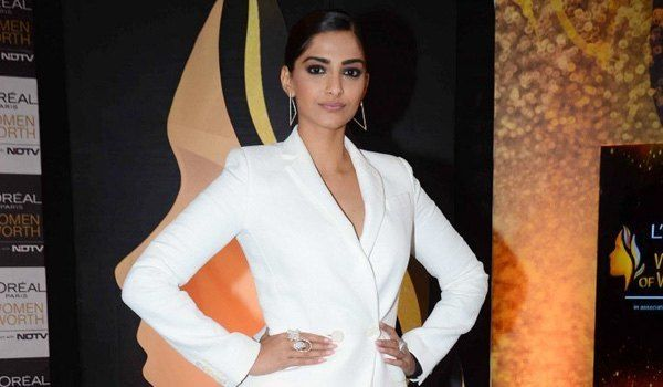 Sonam Kapoor Suit's Up In White –   People are going to stare, make it worth their while!  She knows we stalk her style, and she makes sure we are treated well.  L'oreal India Ambassador, Sonam Kapoor, was recently spotted at the Press Meet for …