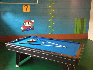 Our Mario themed game room.  Enjoy a game of pool, have some fun, and relax!
