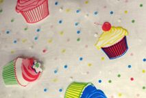 Cup Cake Print Clear Tablecloth Roll (PVC) *Special Order*.  Thick clear tablecover - reusable, robust and easy to clean. Great addition for a party, event or business venue use. Cut to your own specifications. Each printed transparent PVC tablecover roll is 1.6m x 30m long.