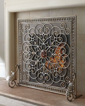 Exclusively ours. Beautifully crafted single-panel fire screen romances the fireplace with interlocking scrolls, fleurs-de-lis, and acanthus leaves. An amber glass medallion accents the center of the screen. Imported.