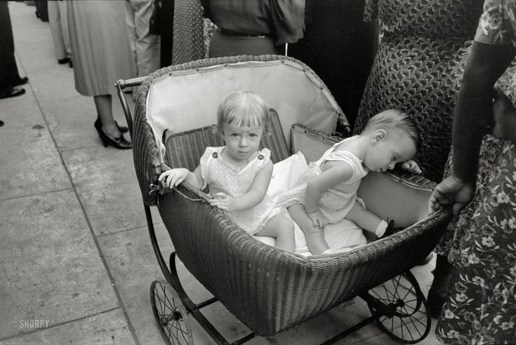 """October 1938. Crowley, Louisiana. """"Children in buggy at National Rice Festival."""" 35mm negative by Russell Lee, Farm Security Administration."""