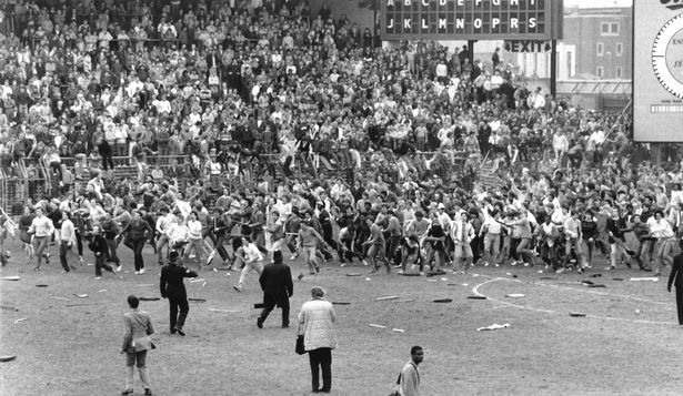 Riot at St Andrews football ground. Birmingham City aka Blues were the home team who were playing Leeds United in a tense last match of the season in the 1984\85 Season. One young fan was killed after a wall collapsed. Many fans and police were injured during the match. The media did not cover the crowd trouble to the same extent as normal because on the same day the Bradford City stadium fire disaster happened killing 56 People and leaving at least 265 injured. 11th May, 1985.