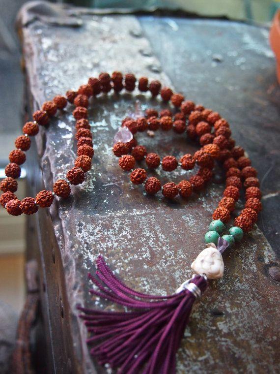 Buddha Mala: rudraksha seeds, turquoise, amethyst, finished with an eggplant tassel and smiling white marble buddha