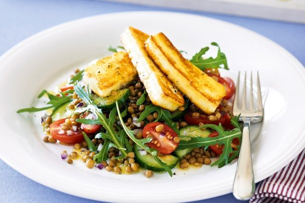 Haloumi, lentil and rocket salad. Haloumi that's crisp on the outside and deliciously soft in the centre is the golden glory on top of this colourful, flavoursome salad.