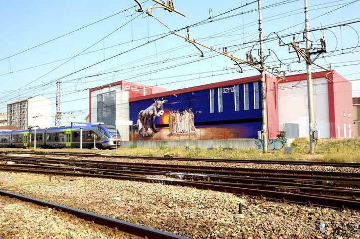 Proseguono i lavoro per l'Urban Art Field Project di Chivasso, seconda pittura per il grande Ozmo che nei giorni scorsi ha terminato di realizzare questa nuova e potente pittura direttamente sulla facciata esterna della Biblioteca MOME, portando in dote un nuova ed intensa riflessione.