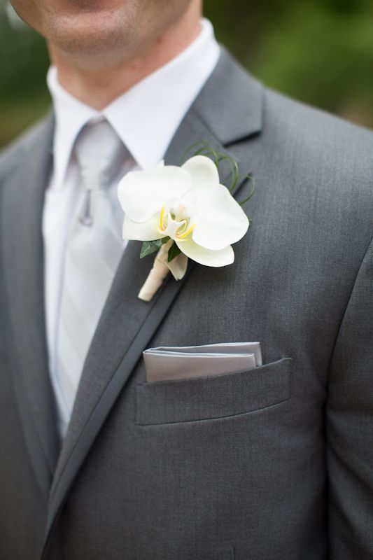 Orchid wedding flower boutonniere, groom boutonniere, groom flowers, add pic source on comment and we will update it. www.myfloweraffair.com can create this beautiful wedding flower look.