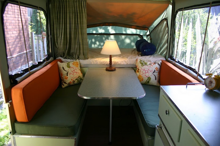 "This isn't exactly ""vintage"" and it's a tent trailer, but I love the colors and they did a really nice job on remodeling and restoring it."